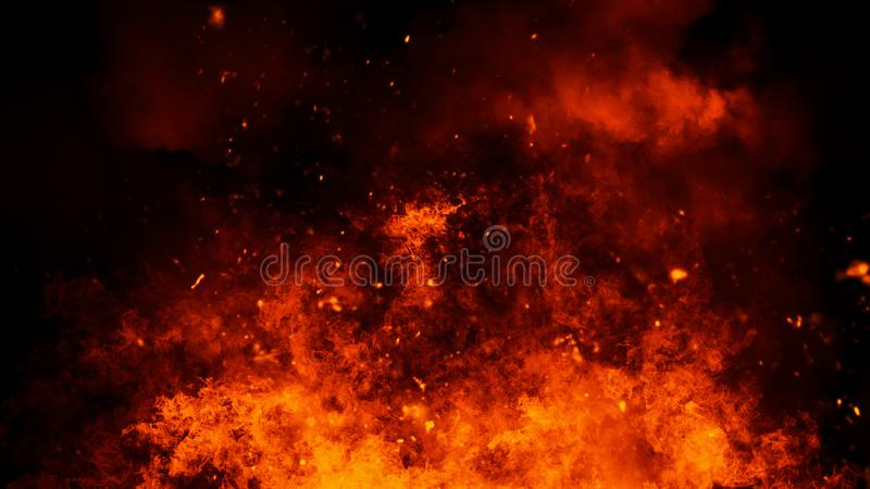 Realistic isolated fire effect for decoration and covering on black background. Concept of particles,flame and light. Realistic isolated fire effect for stock image