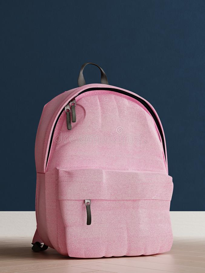 Realistic millennial pink backpack on the wooden floor and prussian blue wall in the background, close up, mock-up royalty free stock images