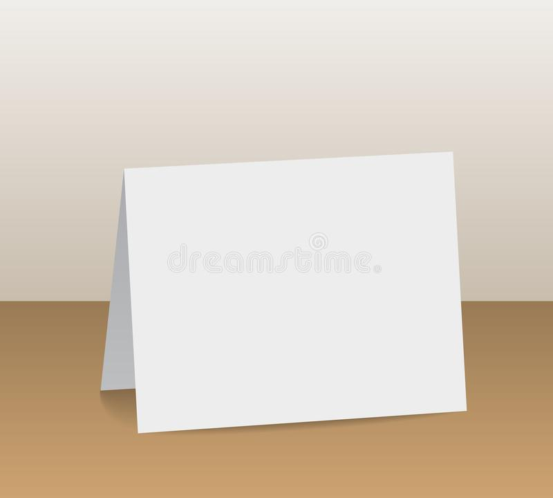 Realistic white blank folded paper card standing on wooden table vector illustration