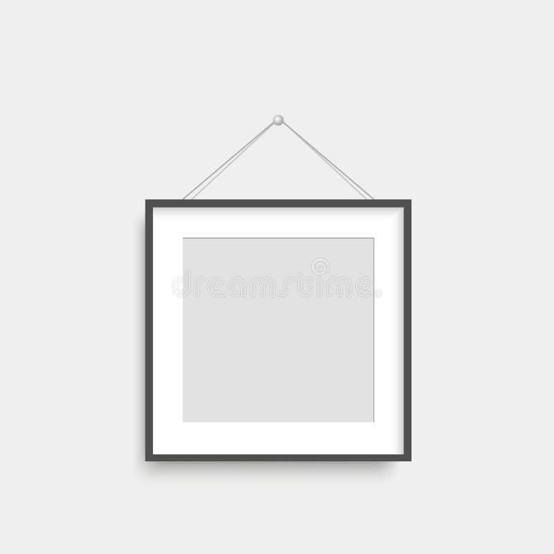 Realistischer schwarzer Fotorahmen, der an der Thwand hängt Vektor stock abbildung