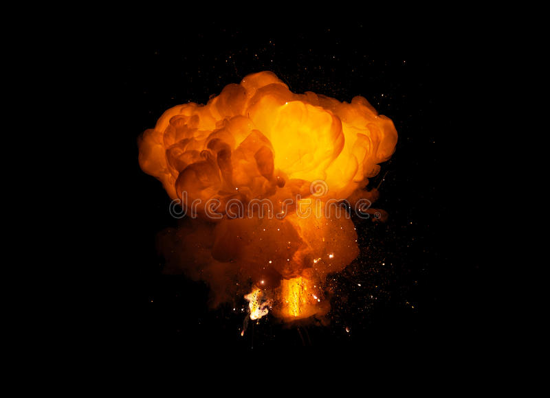 Realistisk brännhet explosion som isoleras på svart bakgrund royaltyfria foton