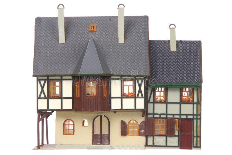 Realistiskt seende plast- hus arkivfoton