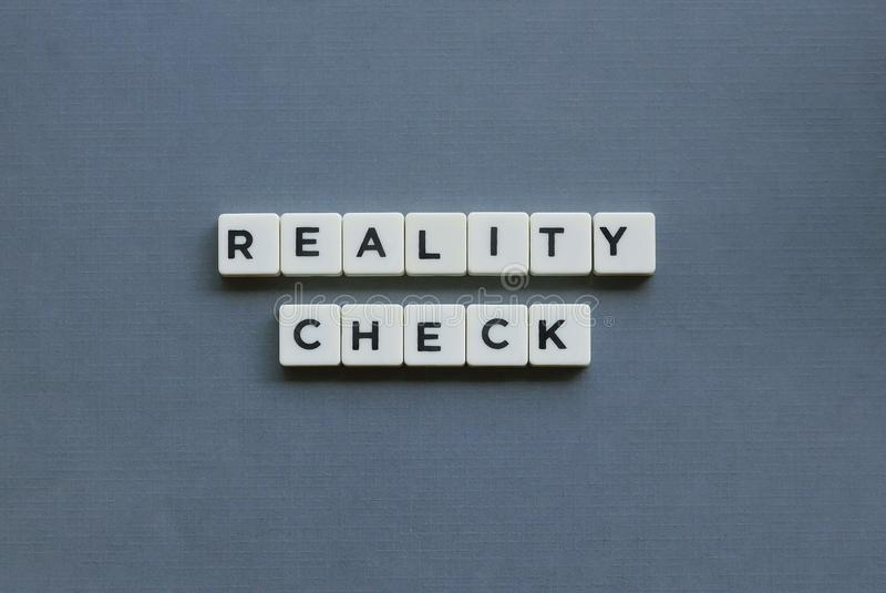 ' Reality Check ' word made of square letter word on grey background royalty free stock photo