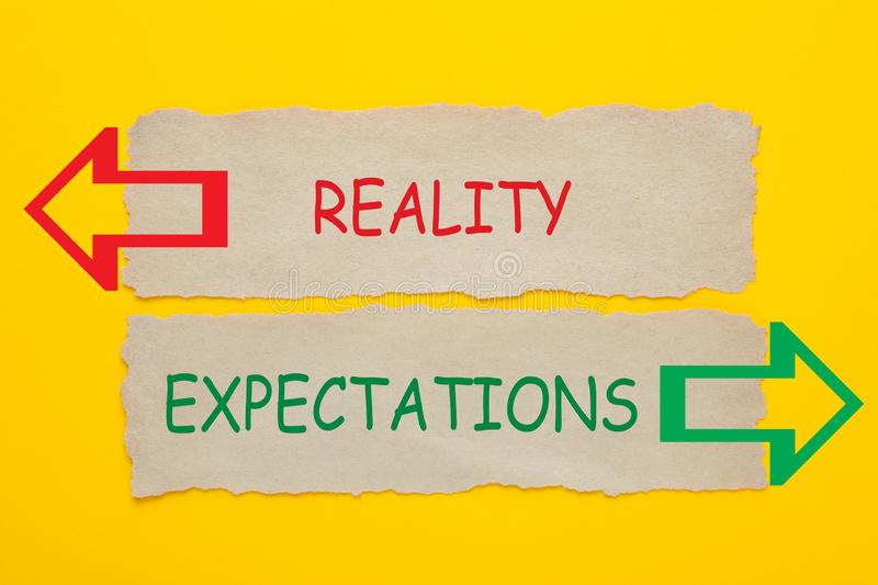 Reality Expectations Concept. Reality vs Expectations words written on old paper on yellow background royalty free stock photo