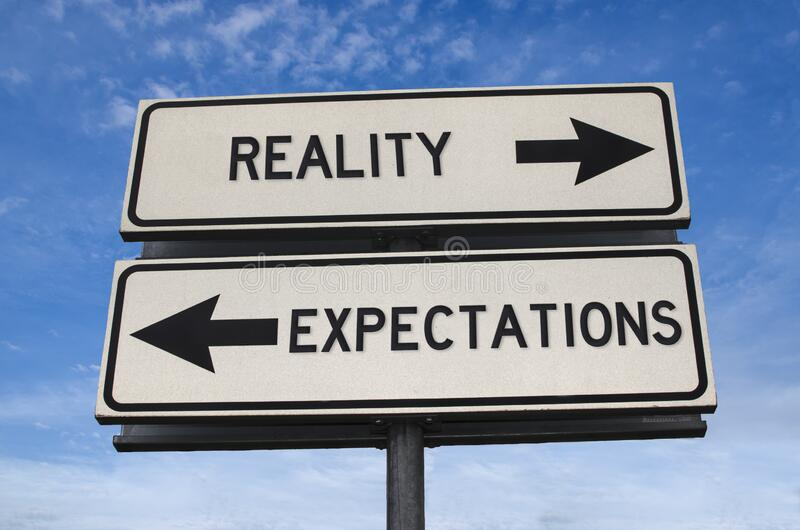 Reality vs expectation White two street signs with arrow on metal pole with word. Reality vs expectation. White two street signs with arrow on metal pole with stock photo