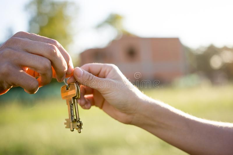 Realtor giving house key yo new owner royalty free stock photography