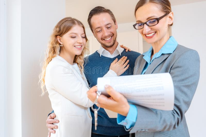 Realtor lady filling in details on new lease contract for apartment stock photos