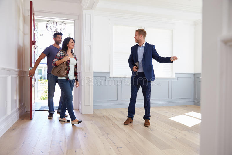 Download Realtor Showing Hispanic Couple Around New Home Stock Image - Image of moving, happy: 71524289