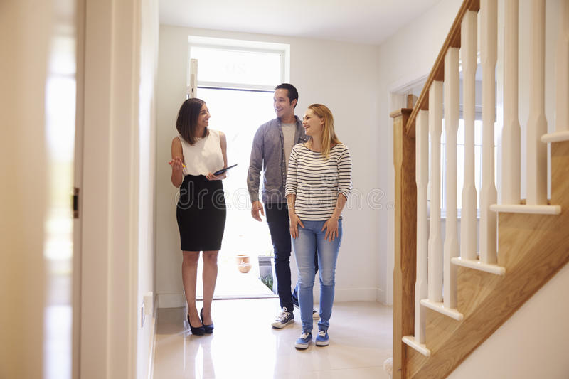 Download Realtor Showing Young Couple Around Property For Sale Stock Photo - Image of male, kitchen: 79802772