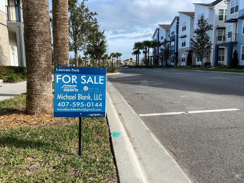A realtor sign in front of a condo that is for sale royalty free stock photos
