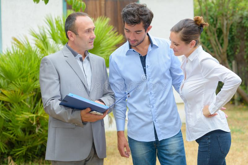 Realtor with young couple. Realtor royalty free stock images