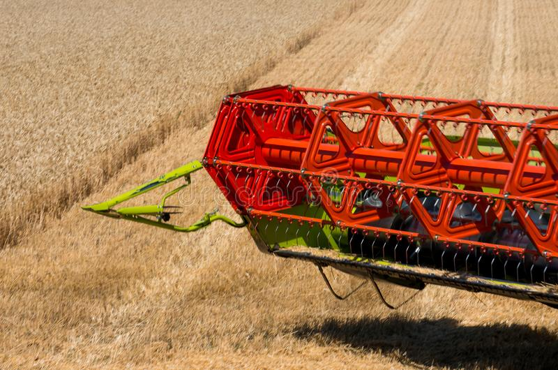 Reaping wheat field working. Harvester machine to harvest wheat field working royalty free stock photo
