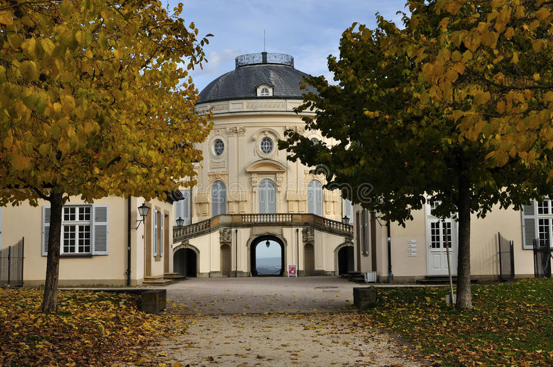 Rear alley schloss solitude. Autumn foresight from the garden alley of the famous castle located in a park in surroundings of the city stock photo
