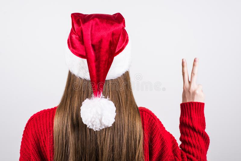 Rear back behind view close up photo portrait of glad beautiful beauty friendly girl giving you v-sign wearing knitted warn jumper stock images
