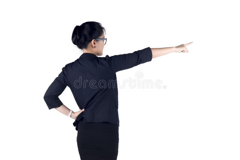 Rear / Back view of business woman standing and pointing. stock photos