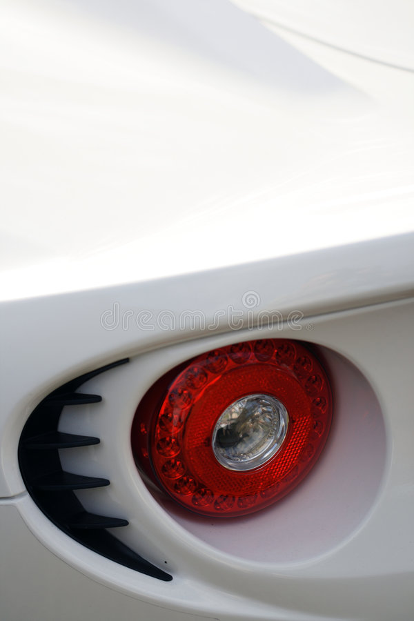 Rear brake light detail on British sports car. Rear brake light detail on a modern British sports car royalty free stock photo