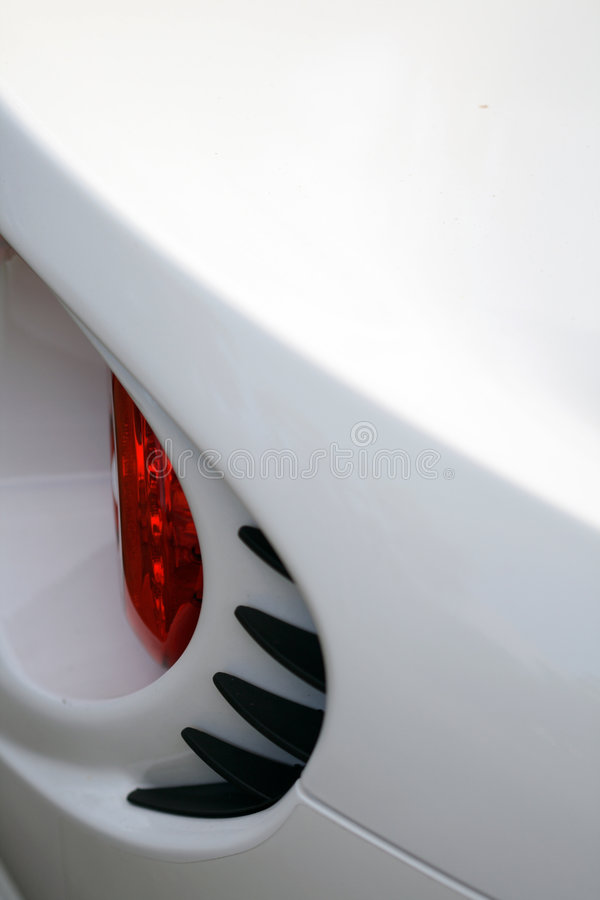 Rear brake light detail on British sports car. Rear brake light detail on a modern British sports car stock image