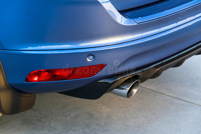 Rear bumper of a car with exhaust pipe, modern car exterior details. stock image