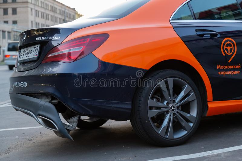Rear bumper fell off after a traffic accident. Road crash. Damaged German automobile stock photos