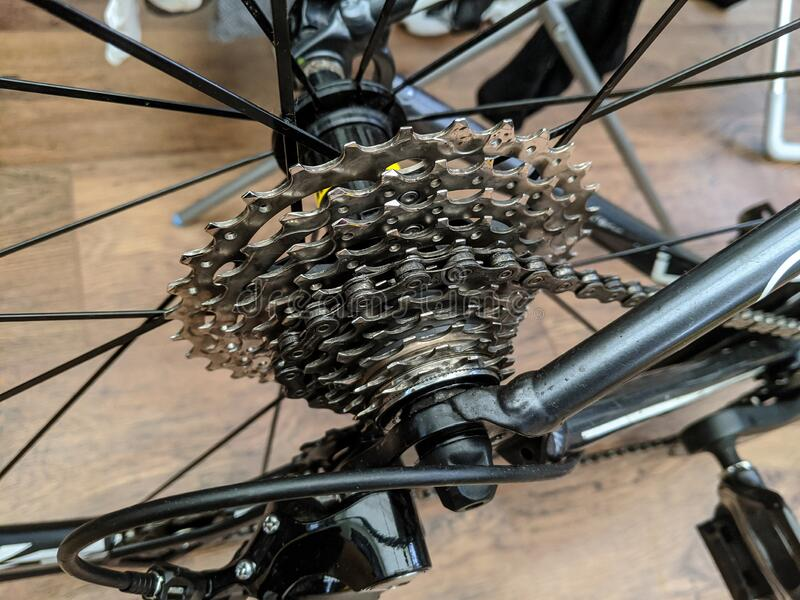 Rear cassette. The rear cassette of a road racing bicycle with a black frame royalty free stock photography