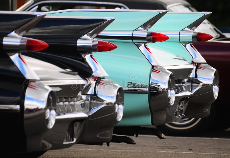 Rear of Cadillacs stock images