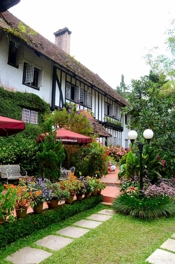 Rear garden and seating area of colonial bungalow Ye Olde Smokehouse Hotel Cameron Highlands Malaysia. Cameron Highlands, Malaysia - June 8, 2017: The rear stock photos