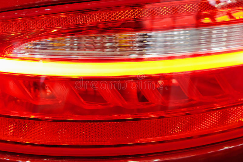 Rear illuminated headlights. Of modern cars royalty free stock images