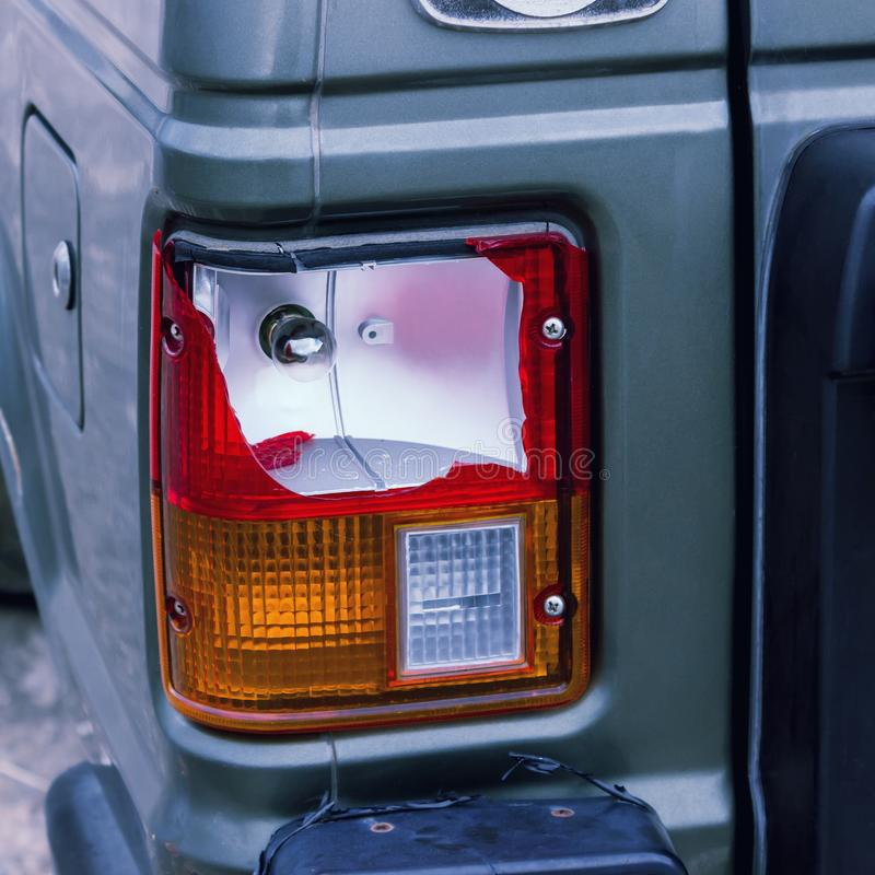 The rear lamp of the silver car broken by the accident. stock photography