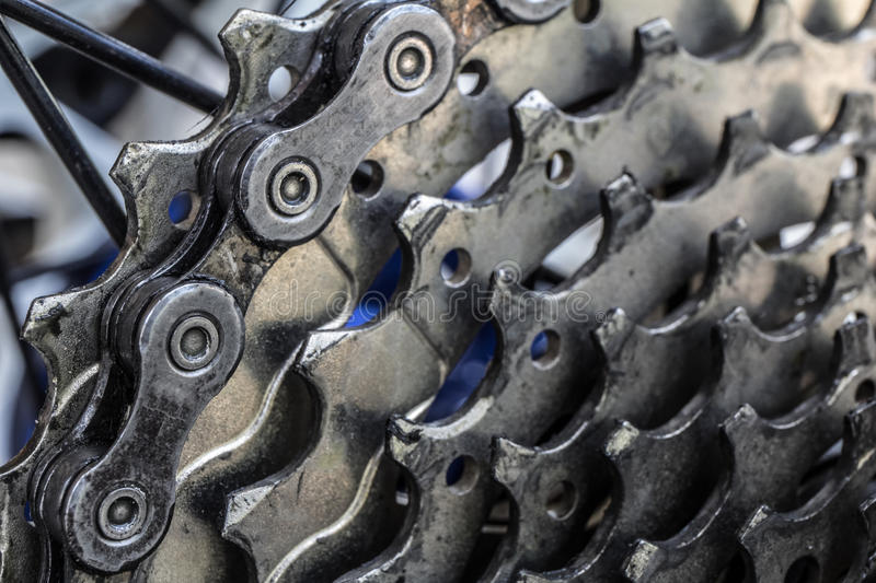 Rear mountain bike cassette on the wheel with chain close up. royalty free stock photography