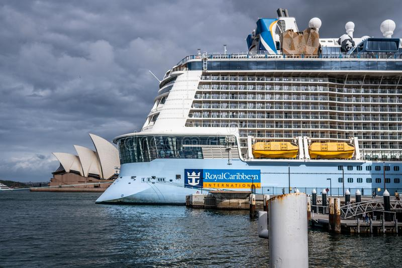 Rear of a Ovation of the seas Royal Caribbean International cruise ship with logo and Sydney Opera house in background. 23th December 2018, Sydney NSW Australia royalty free stock photo