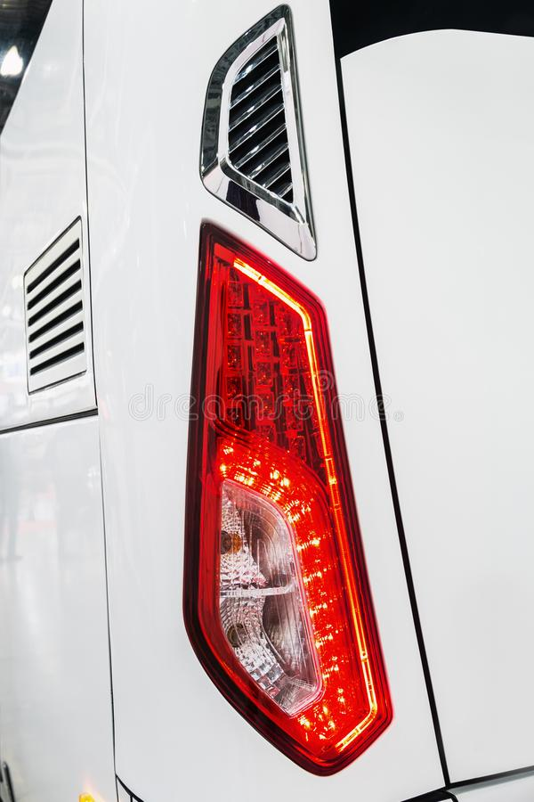 Rear Parking lights of a car, bus or truck. Modern led and halogen lighting stock images