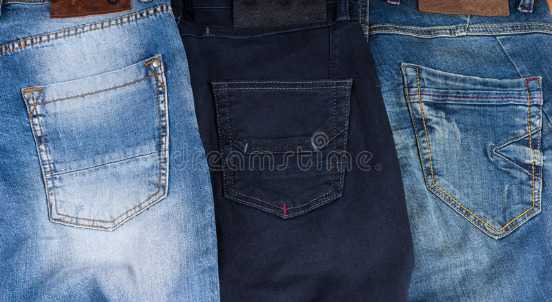 Rear Pockets of Different Styles of Blue Jeans. High Angle View of Rear Pockets of Three Different Styles of Blue Jeans in Various Color Washes royalty free stock image