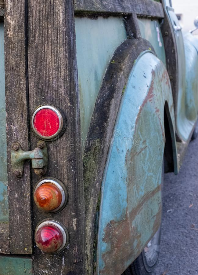 Rear of the popular Morris Minor 1000 model car. This car was also known as the `woody wagon` and is a British design icon. Rear of the popular Morris Minor stock photography