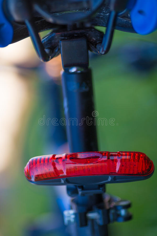 Rear red bicycle lamp. Installed at the seatpost royalty free stock photos