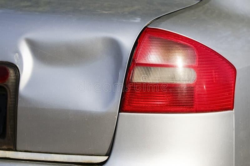 Rear of silver car get damaged by crash stock photos