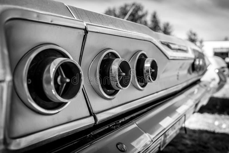 Rear stoplight of the full-size car Chevrolet Impala, 1963. BERLIN - MAY 05, 2018: Rear stoplight of the full-size car Chevrolet Impala, 1963. Close-up. Black royalty free stock photos