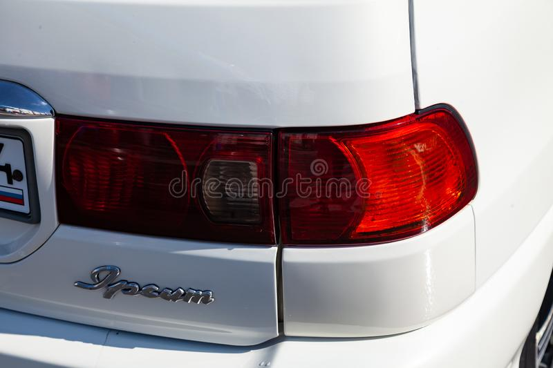 Rear taillamp view of Toyota Ipsum 1998 year in white color after cleaning before sale on parking. Novosibirsk, Russia - 04.10.2019: Rear taillamp view of Toyota stock photography