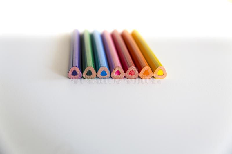 Rear tips of colorful crayons on neutral background. stock photo