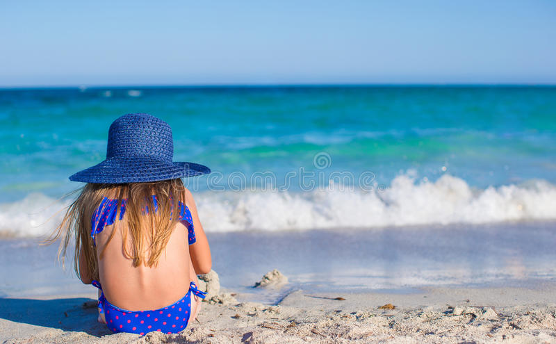 Rear view of adorable little girl in big blue royalty free stock photography