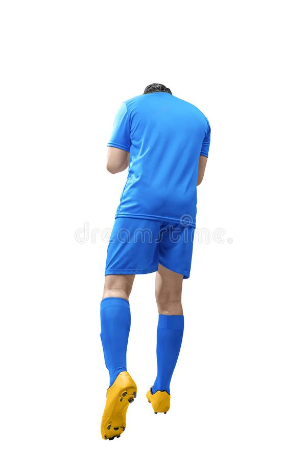 Rear view of asian football player man celebrate his goal stock photography