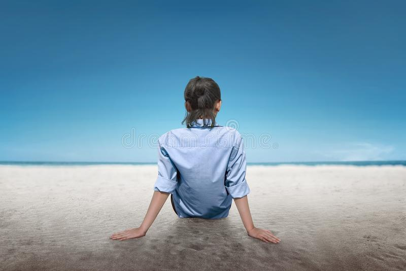 Rear view of asian woman relax and enjoy the view stock photo