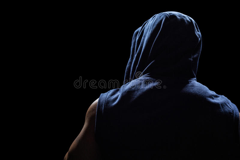 Rear view of athlete. Against black background royalty free stock photography