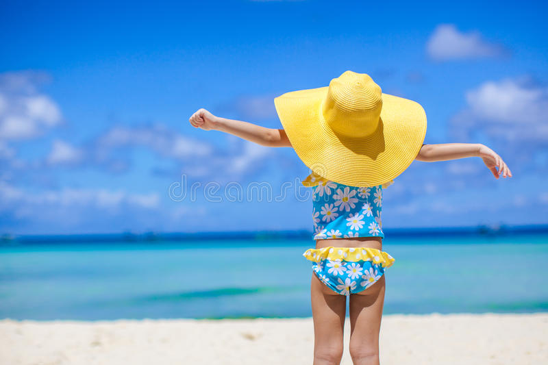 Rear view of baby girl in big hat looking at the stock photography