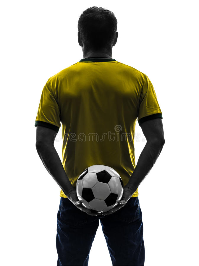 Rear view back man holding soccer football silhouette. One caucasian man holding soccer football silhouette rear view back in silhouette on white background royalty free stock photos