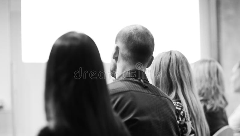 Rear view.the background image of the audience in the conference royalty free stock images