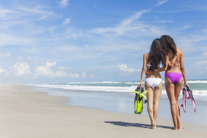 Rear View Beautiful Bikini Women At Beach royalty free stock photo