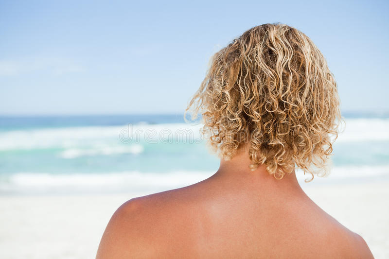 Download Rear View Of A Blonde Man Standing On The Beach Stock Photo - Image: 25333478