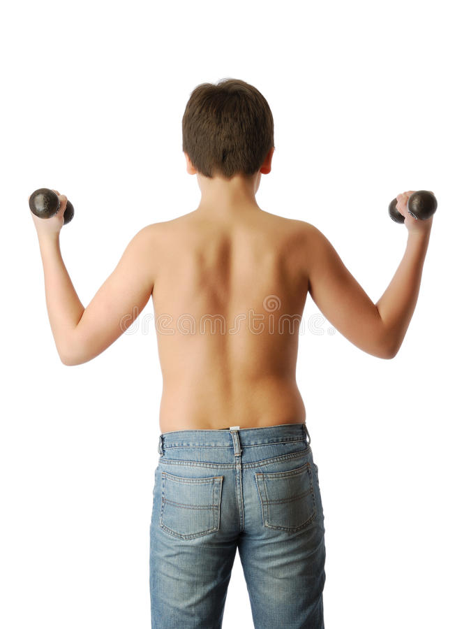 Rear view of boy with dumbbells. stock image