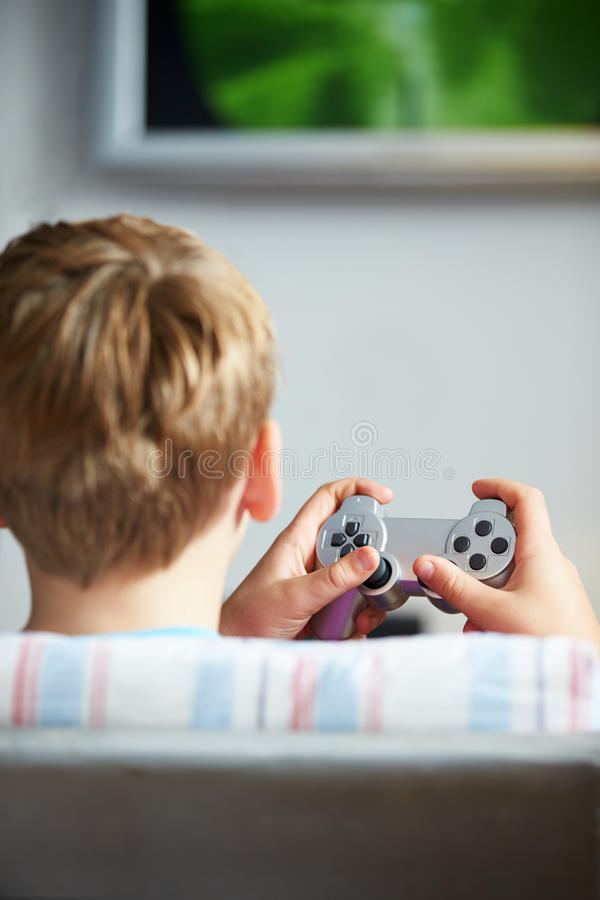 Download Rear View Of Boy Holding Controller Playing Video Game Stock Image - Image: 31860843