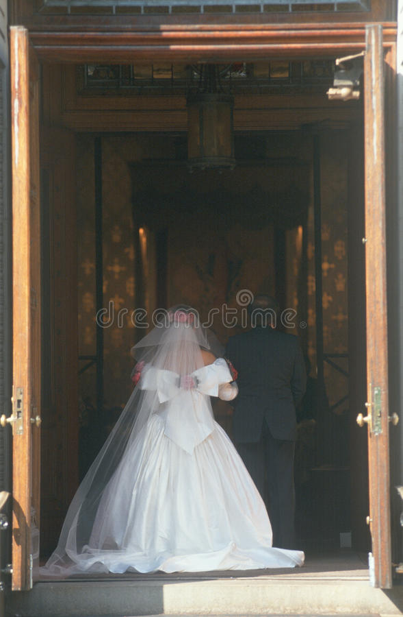 Rear view of Bride entering church royalty free stock photo